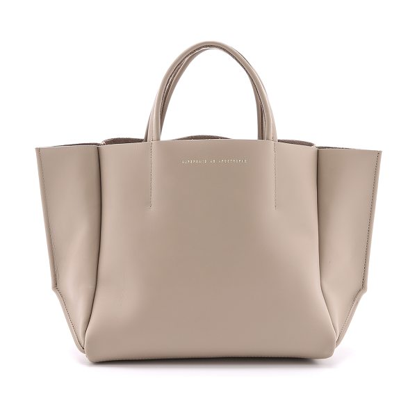 ONE by Ampersand as Apostrophe Half tote in taupe - Description Ampersand as Apostrophe , selected for...