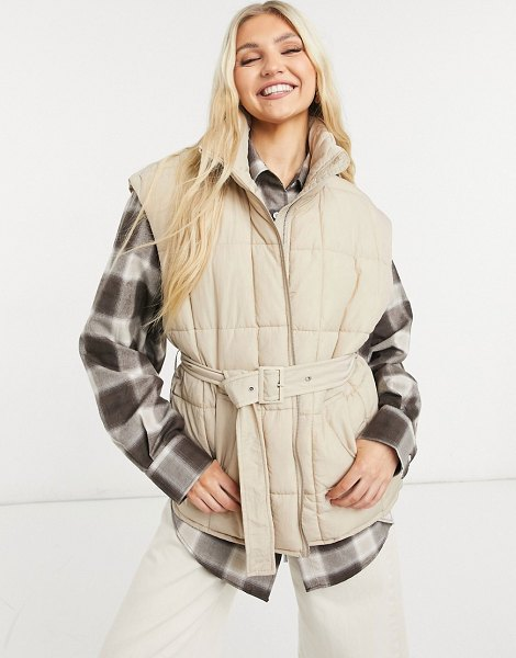 Only quilted vest with belt in beige in beige