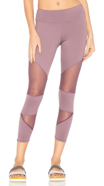 ONZIE Cut Out Capri in purple haze - Shell: 82% poly 18% spandexLining: 100% poly. Contrast...