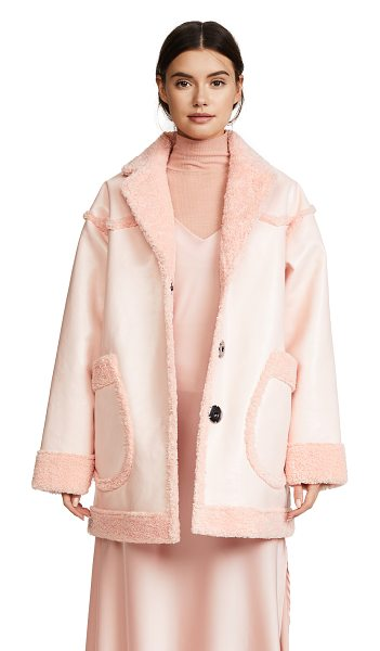 Opening Ceremony reversible patent pink coat in pearl pink - Fabric: Faux shearling / faux leather Reversible...