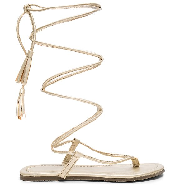 PilyQ Gladiator Sandals in gold - Metallic leather upper with rubber sole. Wrap ankle with...