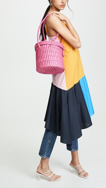 Pitusa lima bag in pink - Fabric: Straw Loop closure at front Unlined Weight: 13oz...