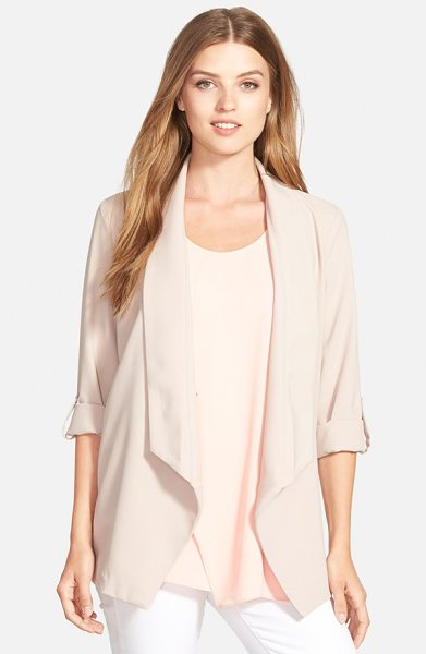 Pleione roll sleeve drape front jacket in taupe - A draped shawl collar and button-tab sleeves lend...