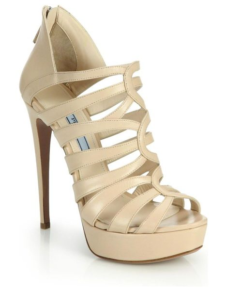 Prada Caged leather platform sandals in nude - Leather straps lattice the front of a sandal, caging the...