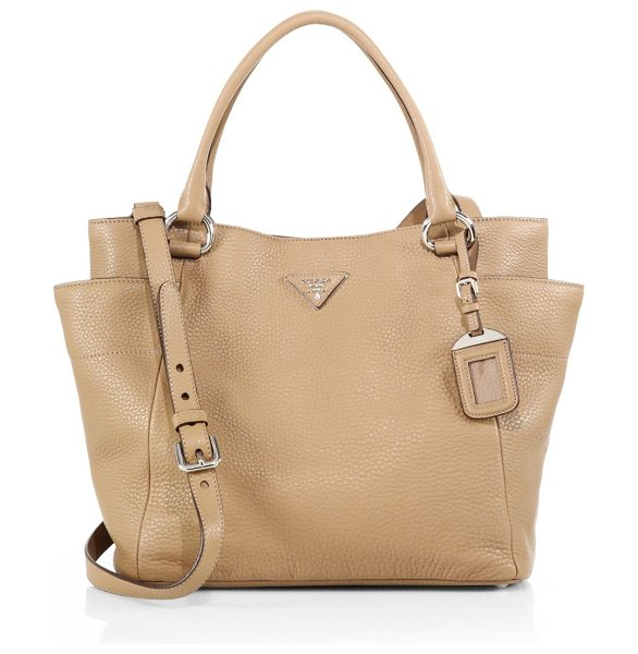 Prada Daino side-pocket hobo bag in beige - Lightly structured in rich pebbled leather, this...