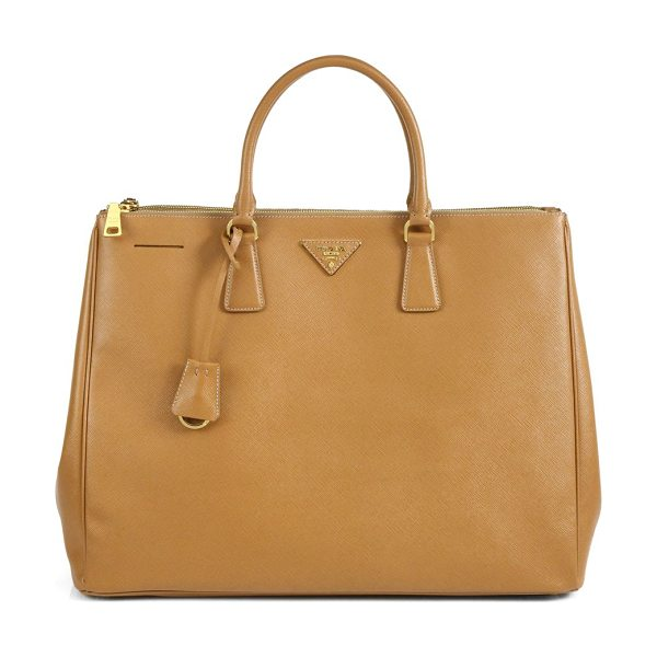 PRADA Large saffiano top-handle bag in caramel - Sumptuous saffiano leather in a top-handle carryall with...