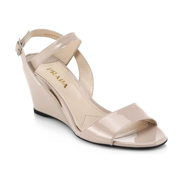 PRADA Patent leather wedge sandals - A mid-height wedge heel gives these understated,...