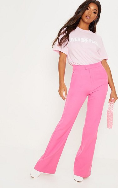PrettyLittleThing baby pink overdressed slogan oversized t shirt in baby pink
