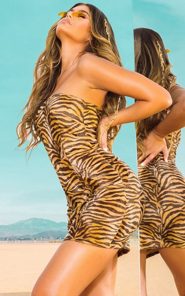 PrettyLittleThing brushed velvet tiger bandeau bodycon dress in tan - Show the world your wild child side with this super...