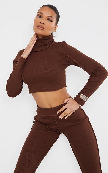 PrettyLittleThing chocolate brown badge structured rib high neck long sleeve crop top in chocolate brown