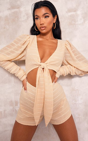 PrettyLittleThing crinkle stripe ruched sleeve tie front romper in champagne