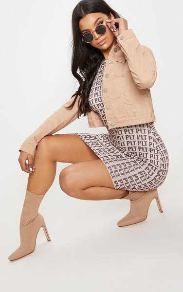 PrettyLittleThing cropped denim jacket in nude - A denim jacket is essential for every occasion and we...