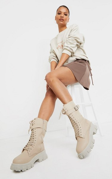 PrettyLittleThing lace up buckle trim cleated sole calf boots in beige