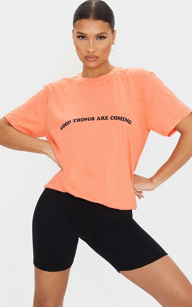 PrettyLittleThing light good things are coming slogan print t shirt in peach