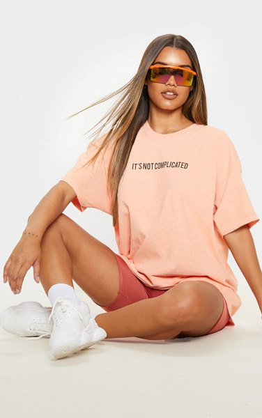 PrettyLittleThing not complicated slogan washed oversized t shirt in peach
