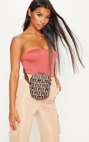 PrettyLittleThing mono cross body bag in brown - A bum bag is practically uniform this season and we are...