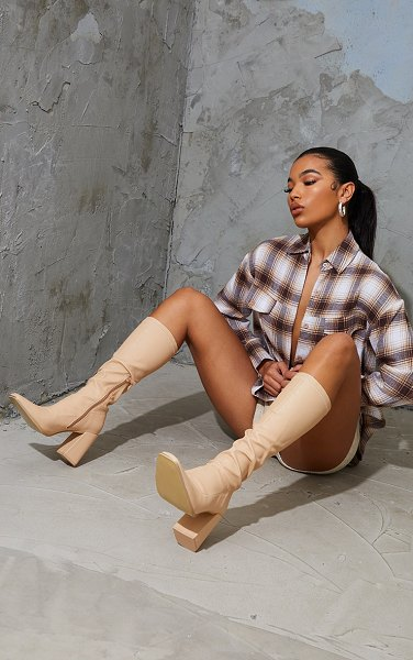 PrettyLittleThing pu toe cap square toe calf heeled sock boots in nude