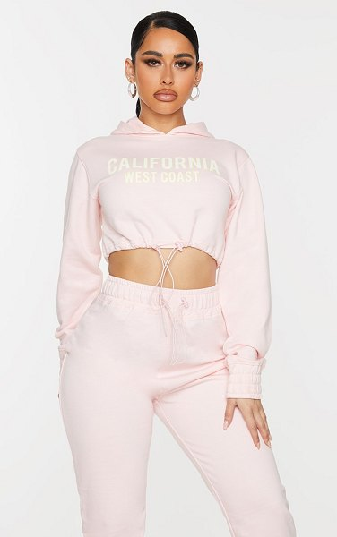 PrettyLittleThing shape baby pink california slogan toggle cropped sweater in baby pink