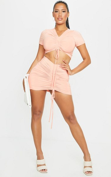 PrettyLittleThing shape slinky ruched front bodycon skirt in peach