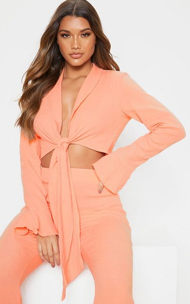 PrettyLittleThing textured long sleeve frill detail blouse in coral