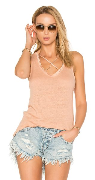 Project Social T Crescent Cross Strap Tank in peach - Cotton blend. Crisscross front strap detail. Jersey knit...