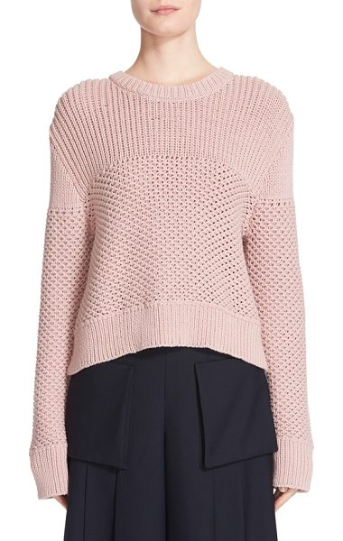 Public School sweater in pink - Mixed stitches add depth and dimension to a cropped,...