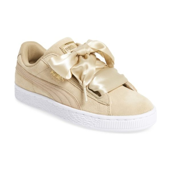 PUMA basket heart sneaker in pink - Exaggerated wide laces and sporty styling update the...