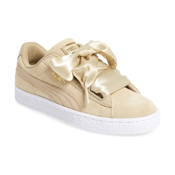 PUMA basket heart sneaker in cream - Exaggerated wide laces and a glossy patent finish update...