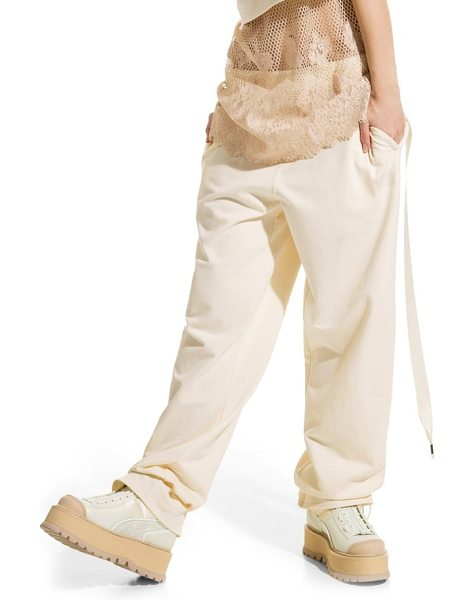 PUMA fenty  by rihanna gathered ankle sweatpants in vanilla ice - These tough-luxe sweatpants are framed with an elegant...