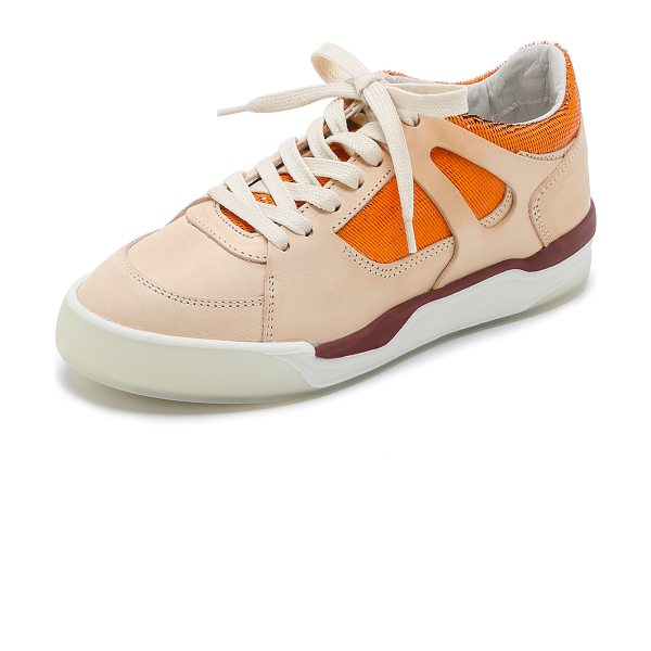 PUMA Mcq move femme low top sneakers in natural/fluo flash orange
