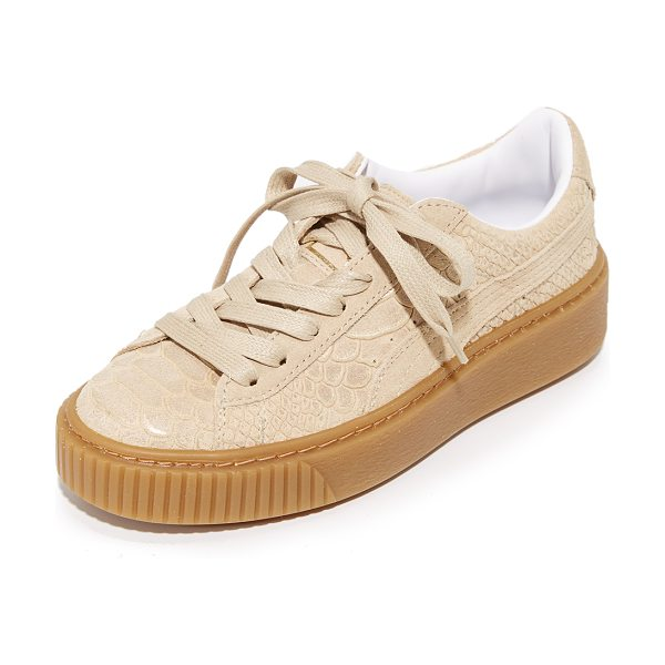 PUMA platform sneakers - Brushed metallic accents add an edgy glamour to these...
