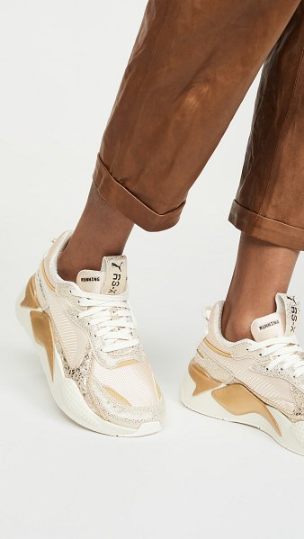 PUMA rs-x winter glimmer sneakers in white/black/team gold