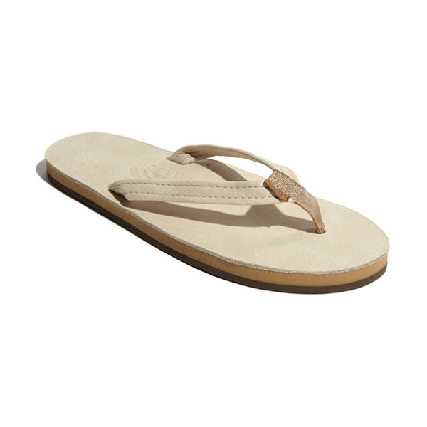 Rainbow narrow strap sandal in sand - A casual flip-flop features layers of sponge memory...