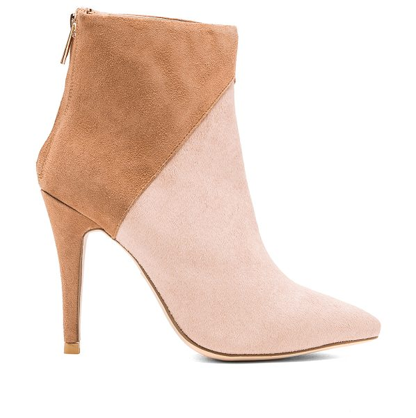 RAYE Jordan cow hair bootie in tan - Cut and dyed cow hair and leather upper with rubber...