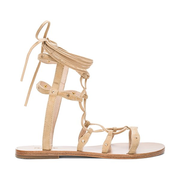 RAYE Sage Sandal in beige - All laced up in the details. RAYE?s Sage Sandals feature...
