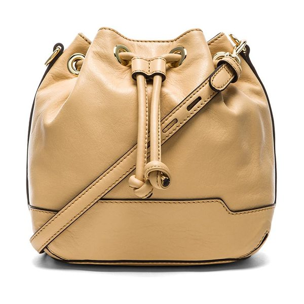 Rebecca Minkoff Mini fiona bucket bag in beige - Leather exterior with printed fabric lining. Measures...