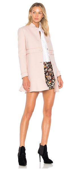 Red Valentino Peplum Coat in nude - Red Valentino takes a romantic stance on outerwear with...