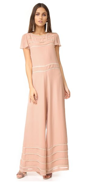 RED VALENTINO wide leg embroidered jumpsuit - Scalloped lace trim adds charming detail to this...