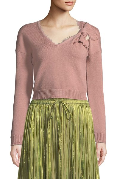 Red Valentino Wool V-Neck Sweater with Bow Detail in rose - REDValentino sweater with bow and cutout detail at left...