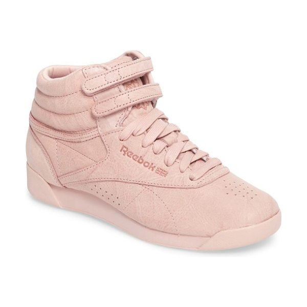 Reebok freestyle hi sneaker in polish pink - With a minimalist look that still delivers maximum...