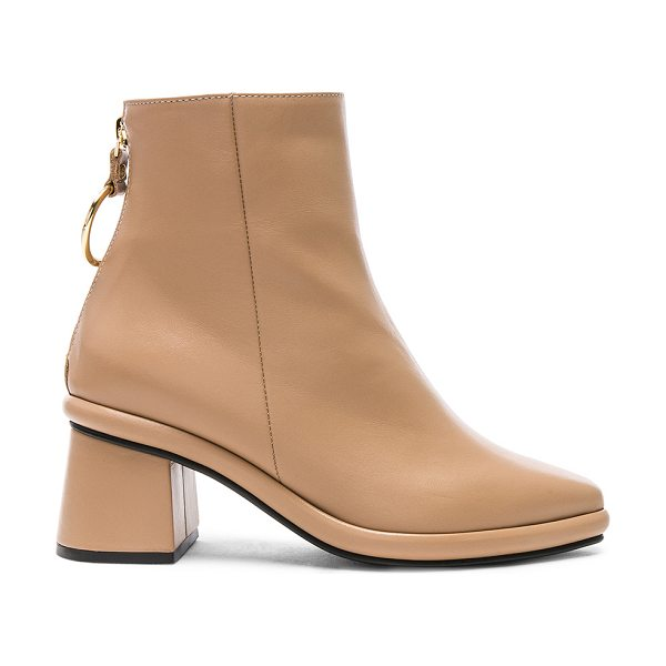 Reike Nen Leather Ring Slim Boots in neutrals - Leather upper with rubber sole.  Made in Korea.  Shaft...