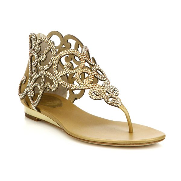 Rene Caovilla Swirl strass leather flat sandals in gold - Swirly cutout flat sandal in dazzling Swarovski...