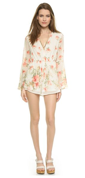 Reverse Bell sleeve romper in cream floral - Rose prints accent this airy Reverse romper. Plunging...