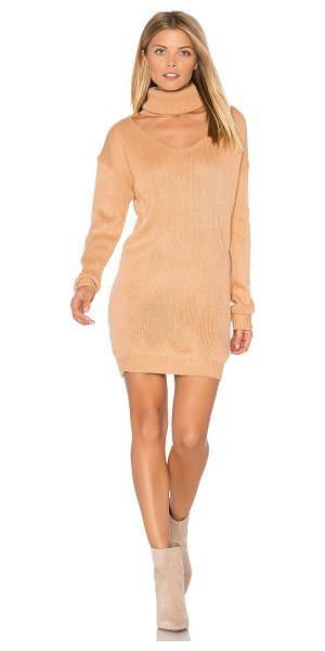 Reverse Cut It Out Sweater Dress in peach - 100% acrylic. Hand wash cold. Unlined. Knit fabric. Back...