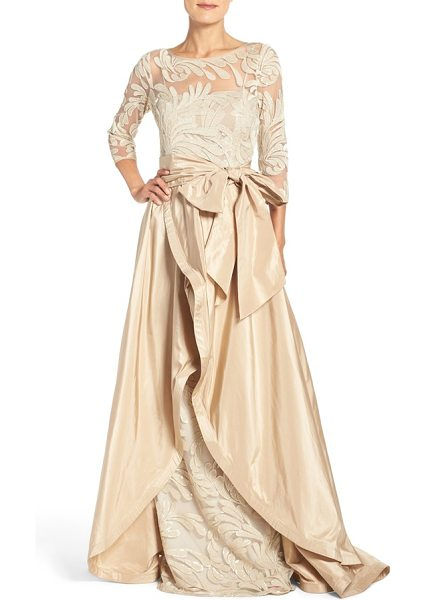 Rickie Freeman for Teri Jon embroidered mesh gown with taffeta overlay in champagne - Leafy embroidery styles the illusion bodice of a regal...