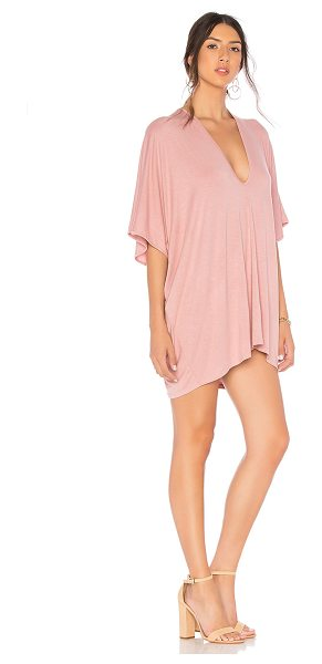 Riller & Fount Lola Dress in blush - 95% rayon 5% spandex. Unlined. V-shaped neckline. Made...