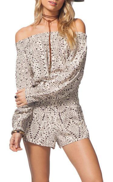 Rip Curl sun shadow off the shoulder romper in vanilla - A confetti-like geo print adds playful embellishment to...
