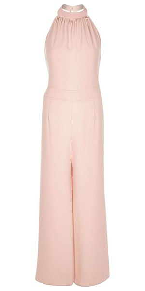River Island pink halter neck wide leg jumpsuit in pink - Satin crepe Halter neck Wide leg Ruched top Our model...