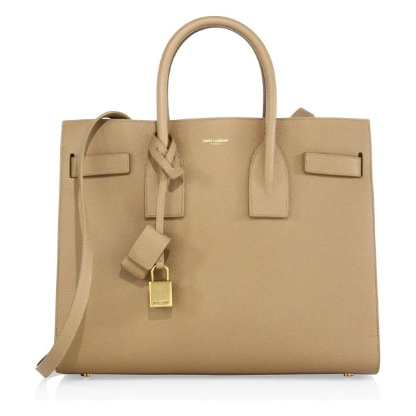 Saint Laurent small sac de jour leather tote in deep beige - Sophisticated signature with a structured silhouette....
