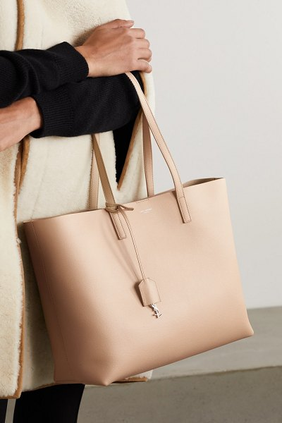 Saint Laurent east west large leather tote in beige